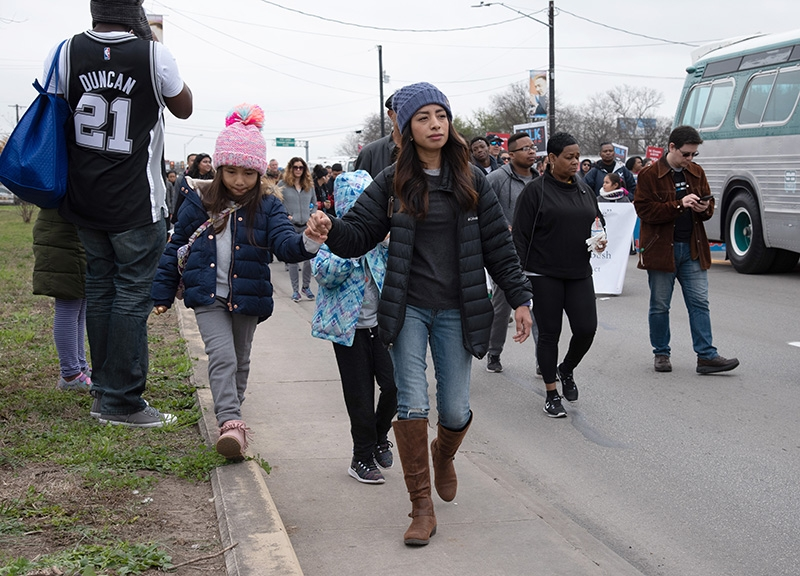 Camila Cavazos, 6, walks with mother Viviana Cavazos during the annual MLK March Monday. Cavazos said she marches so her daughter can see what Dr. King's legacy is about. Photo by V. Finster | Heron Contributor