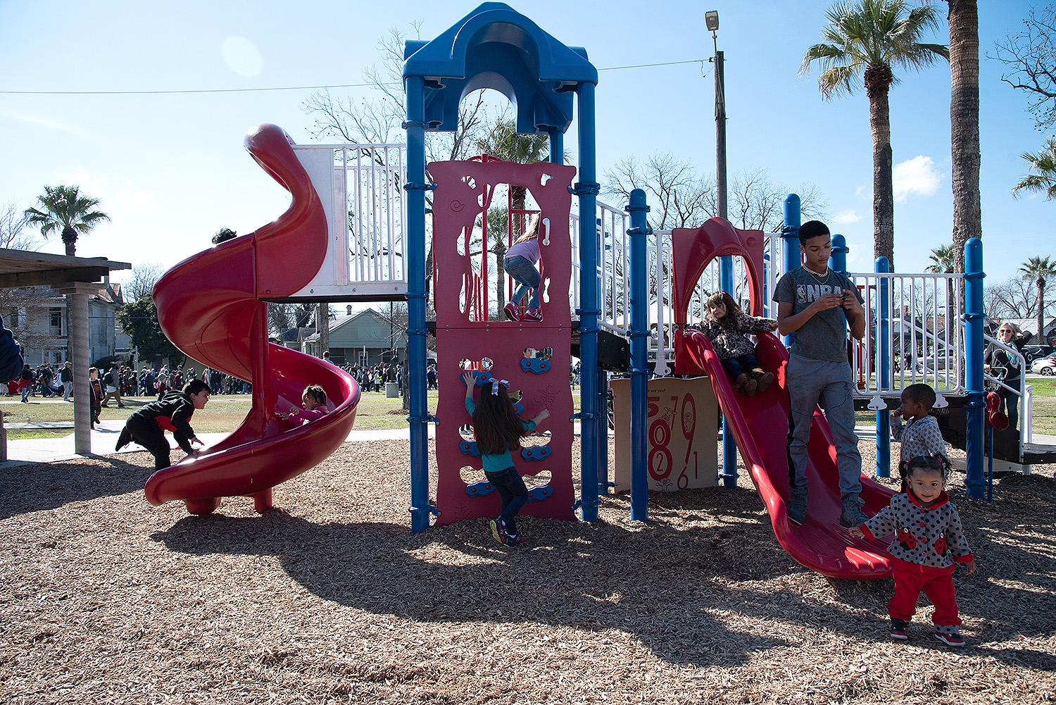 Children climb a playscape during the annual MLK March on Monday. Photo by V. Finster | Heron Contributor
