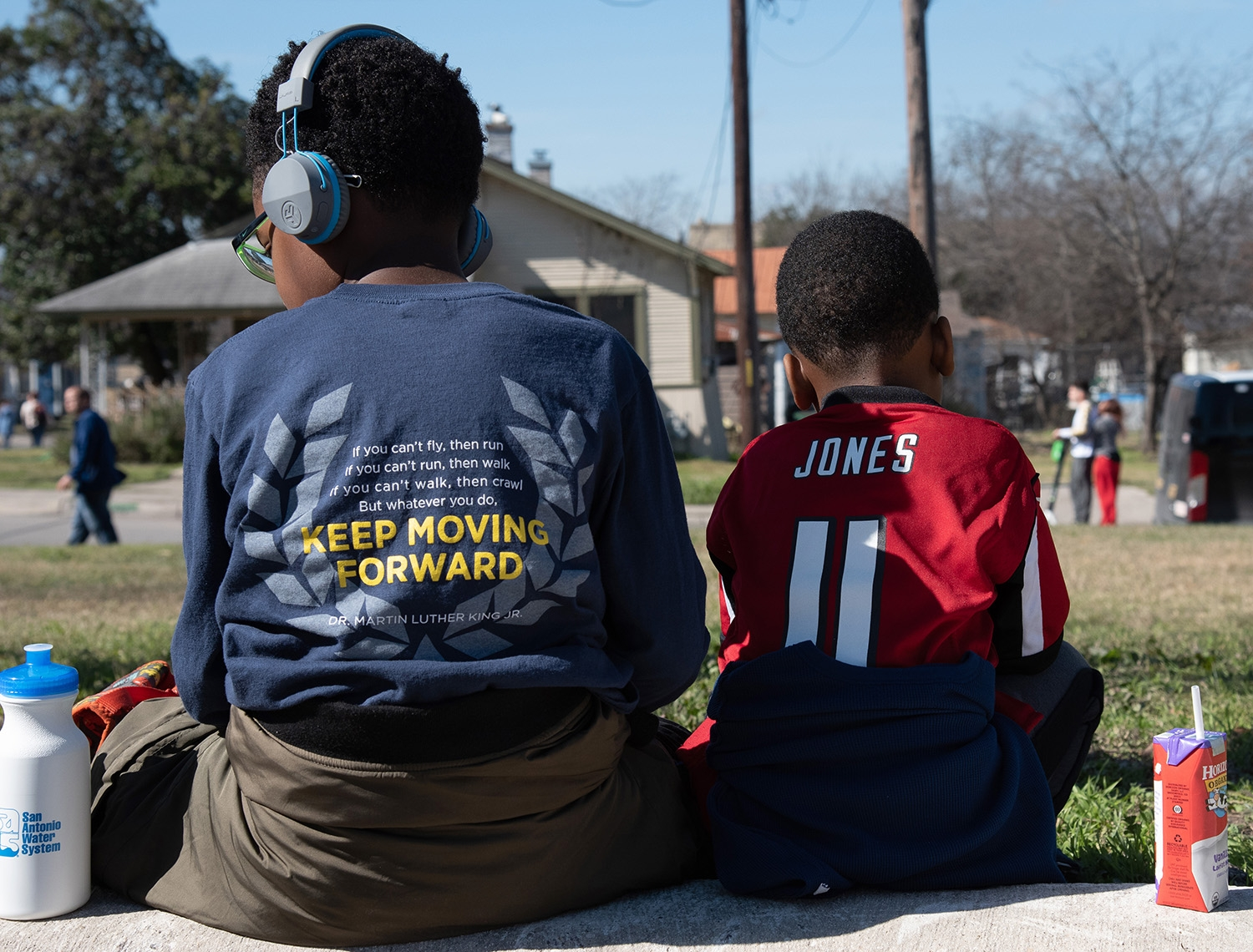 Cameron, 9, and Jordan Brown, 6, rest after the annual MLK March Monday. Photo by V. Finster | Heron Contributor