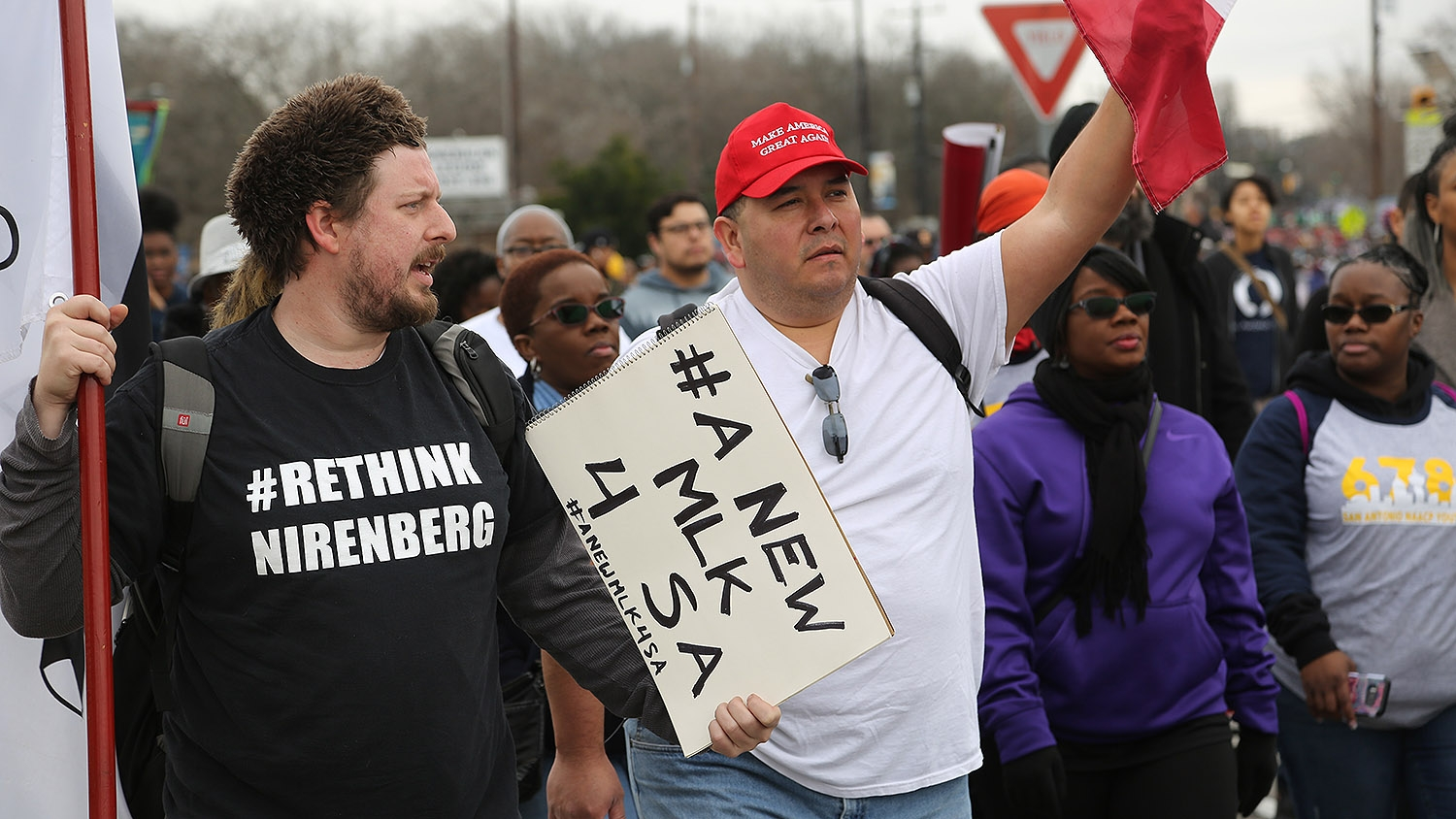 Christian Lee (left) and Randolph Macias participate in the annual MLK March. Photo by Ben Olivo | Heron