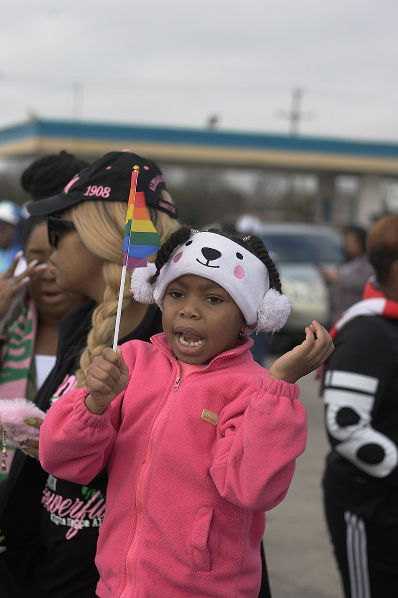 Chloe Garza, 6, participates in the MLK March Monday on San Antonio's East Side. Photo by Noah Alcala Bach | Heron Contributor