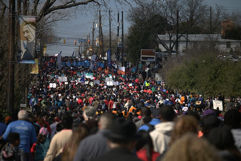 Thousands of people make their way up Martin Luther King Jr., Drive during the annual MLK March on Monday. Photo by Noah Alcala Bach | Heron Contributor