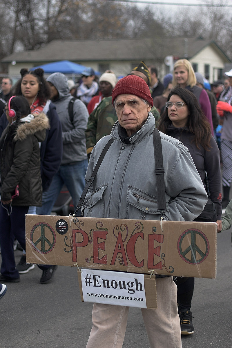 John Q. Paraini, 71, participates in the MLK March Monday on San Antonio's East Side. Photo by Noah Alcala Bach | Heron Contributor
