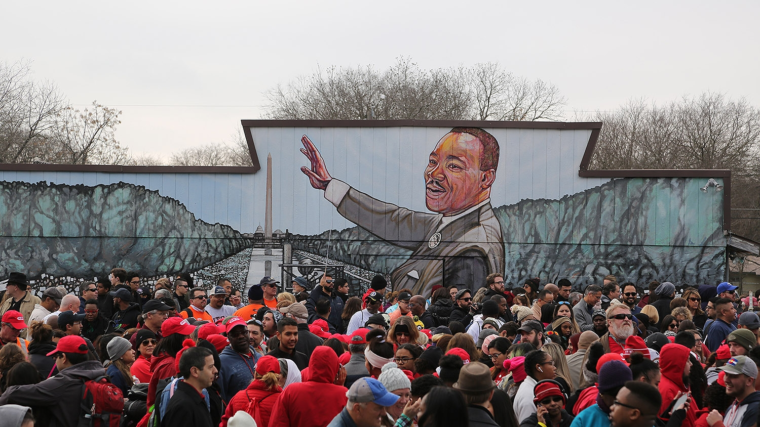 People gather on Martin Luther King Jr., Drive for the MLK March Monday morning. Photo by Ben Olivo | Heron