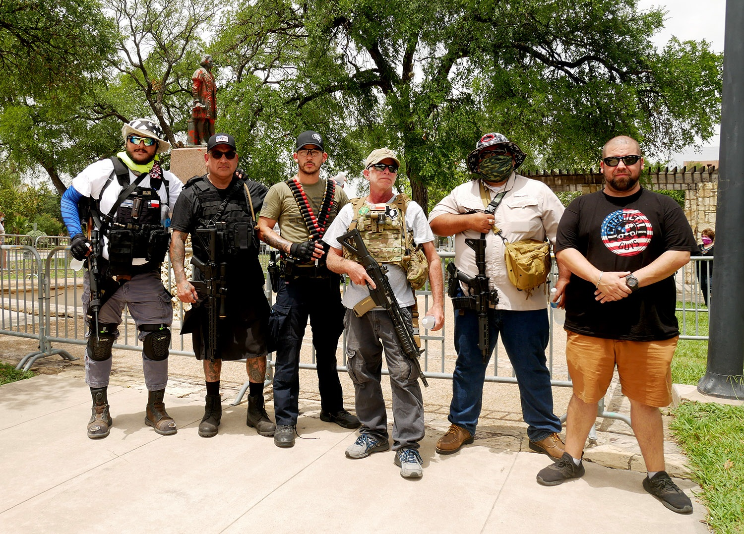 Victor Javier Zamora, 29 (from left); Roger Rodkey, 52; Steven Ruiz, 33,: John May, 51; Robert N., 42; and Marc F., 45, pose for a photo Saturday at Columbus Park.