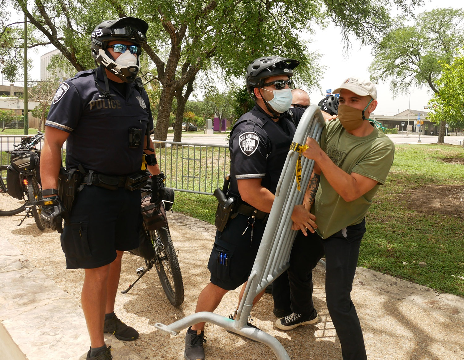 Jovanni Reyes and police officers clash during a protest for the removal of the Columbus statue Saturday, June 27, 2020, at Columbus Park, 200 Columbus St. Photo by Michelle Delrey | Heron contributor