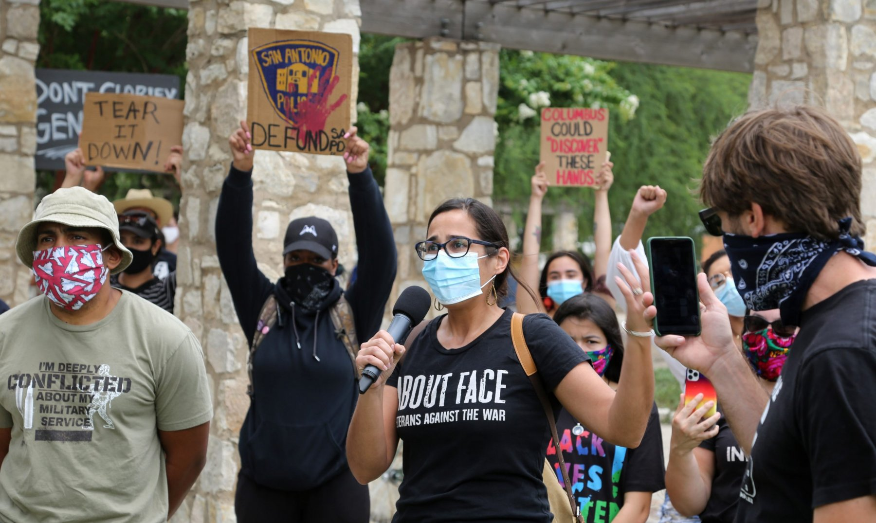 Rachell Tucker speaks to a group of roughly 50 advocates for the removal of the Christopher Columbus statue during a protest Saturday, June 27, 2020, at Columbus Park, 200 Columbus St. Photo by Ben Olivo | Heron