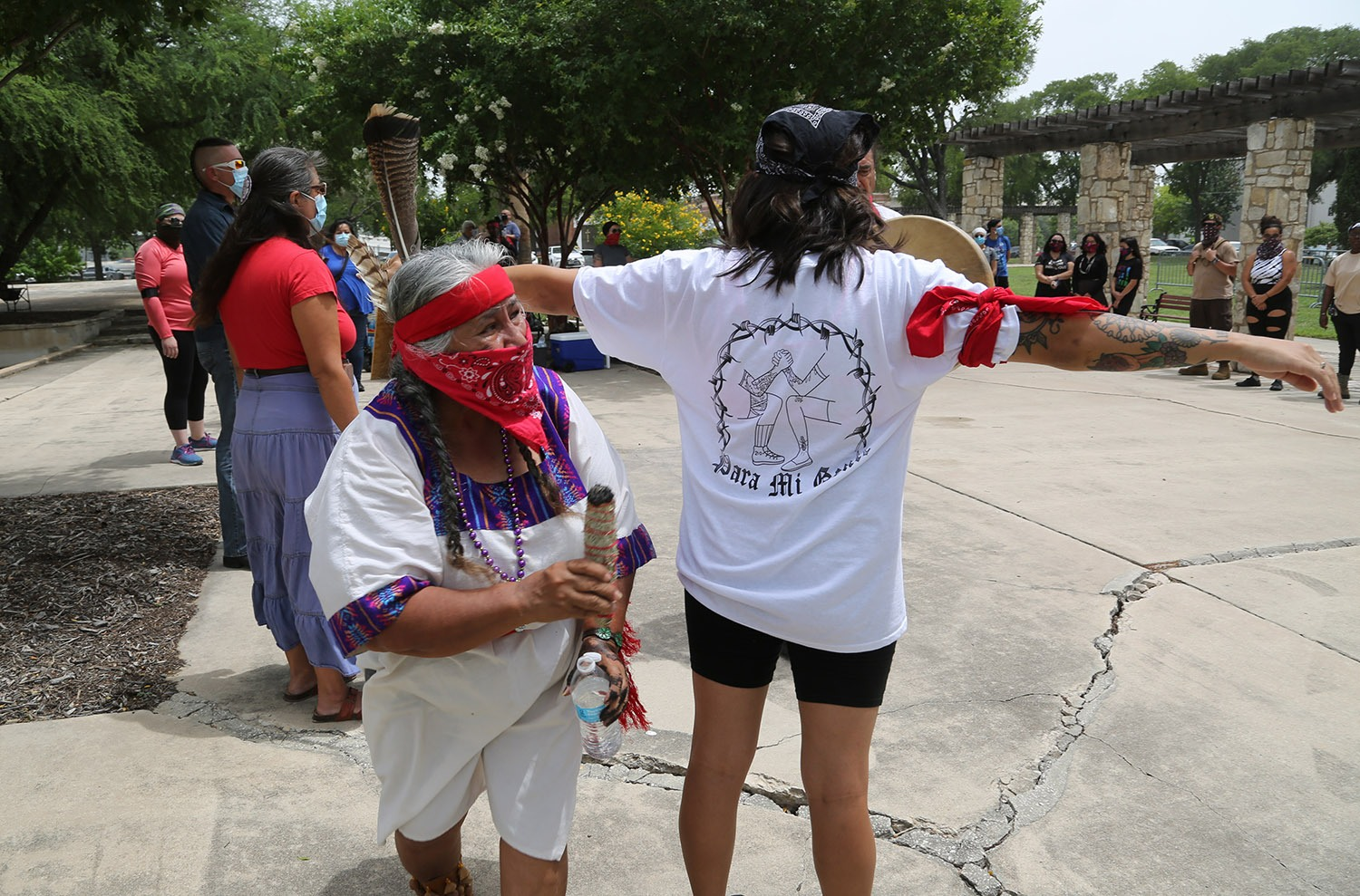 Diana Uriegas performs a safe cleaning prayer on an advocates for the removal of the Christopher Columbus statue during a protest Saturday, June 27, 2020, at Columbus Park, 200 Columbus St. Photo by Ben Olivo | Heron