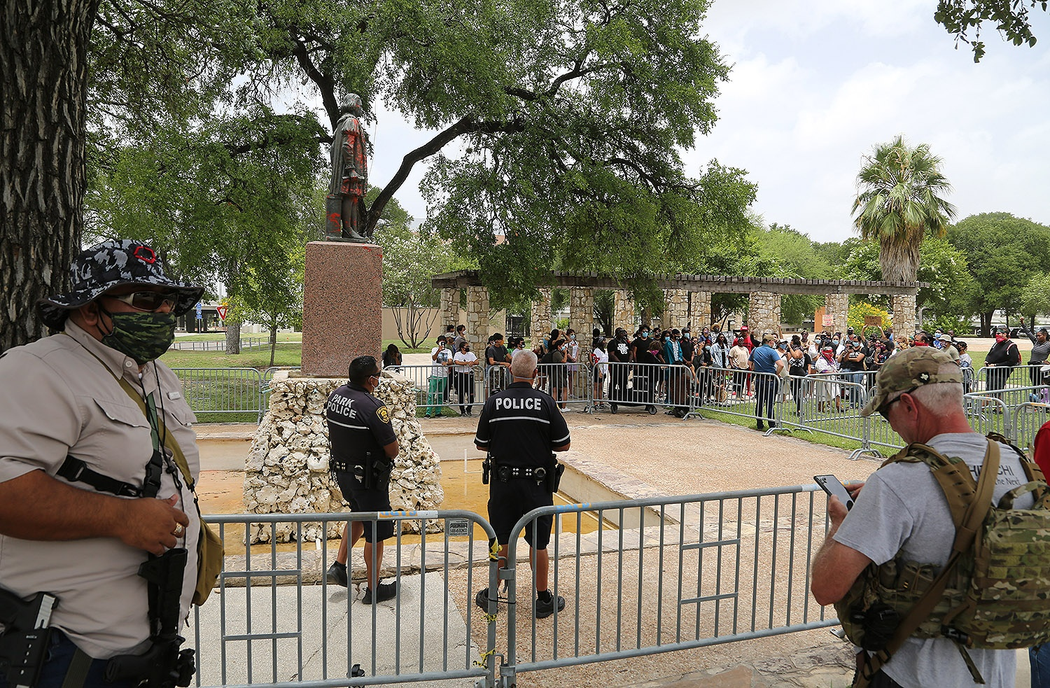 Barricades separate advocates for the removal of the Christopher Columbus statue and armed men who want to see it stay in place Saturday, June 27, 2020, at Columbus Park, 200 Columbus St. Photo by Ben Olivo | Heron