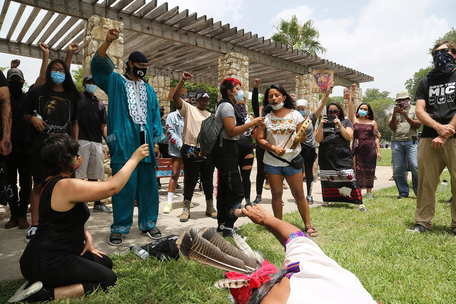 Ceiba leads a group of roughly 50 advocates for the removal of the Christopher Columbus statue in song during a protest Saturday, June 27, 2020, at Columbus Park, 200 Columbus St. Photo by Ben Olivo | Heron