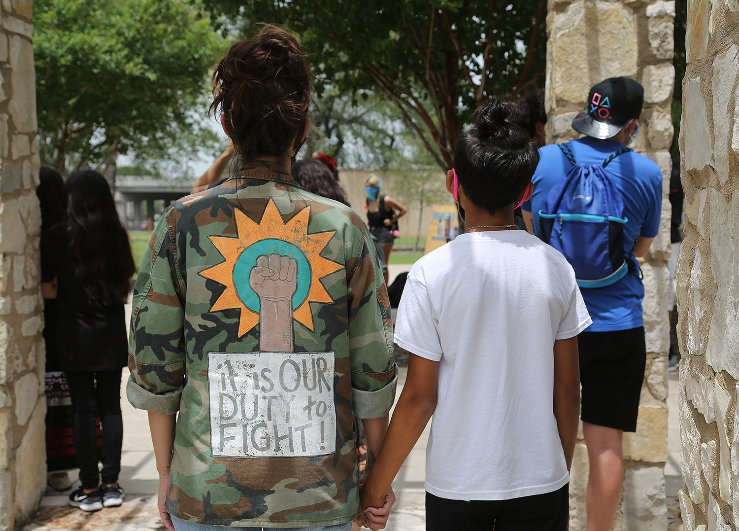 Advocates for the removal of the Christopher Columbus statue protest Saturday, June 27, 2020, at Columbus Park, 200 Columbus St. Photo by Ben Olivo | Heron