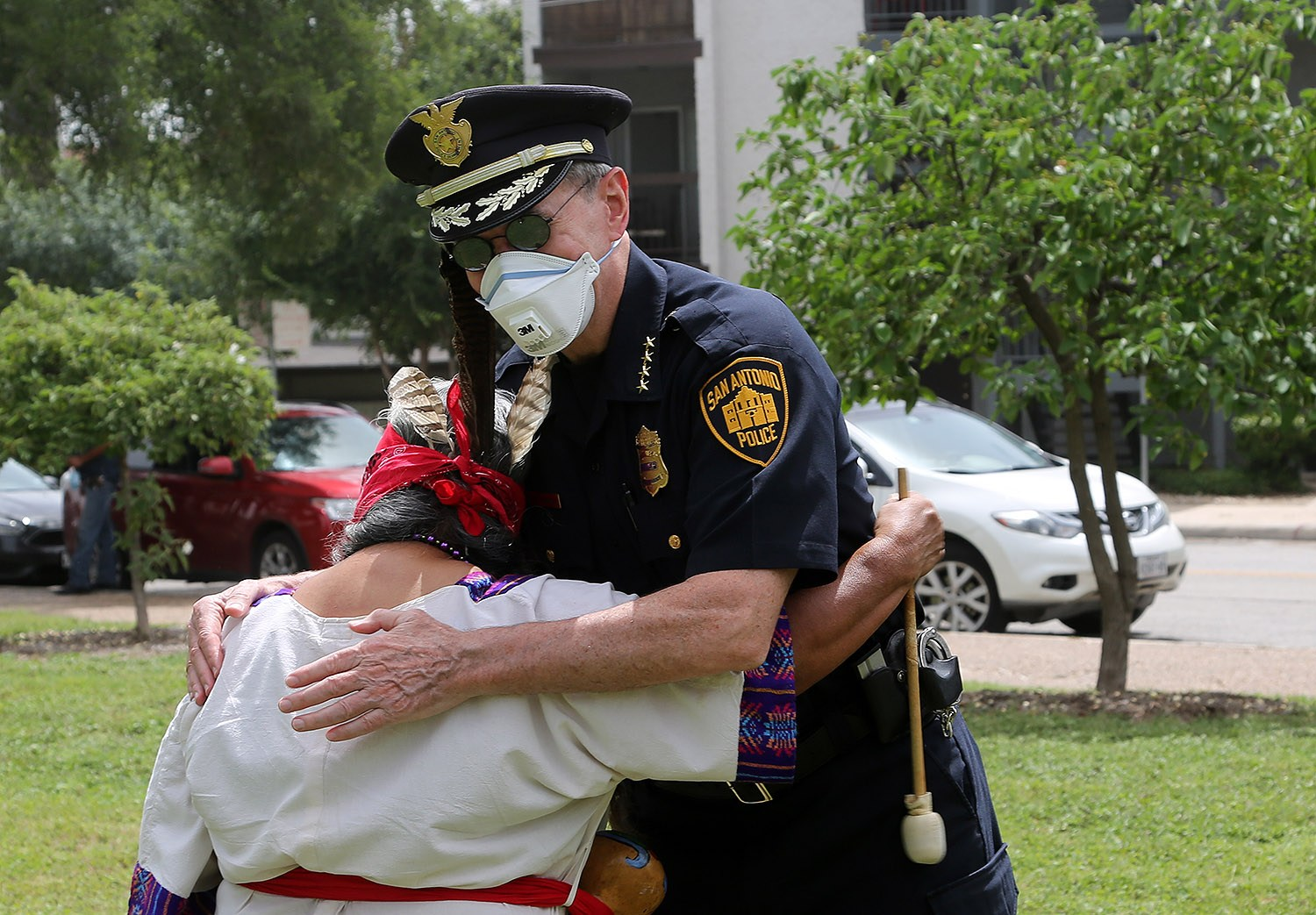 San Antonio Police Chief William McManus hugs Diana Uriegas before a protest for the removal of the Christopher Columbus statue Saturday, June 27, 2020, at Columbus Park, 200 Columbus St. Photo by Ben Olivo | Heron
