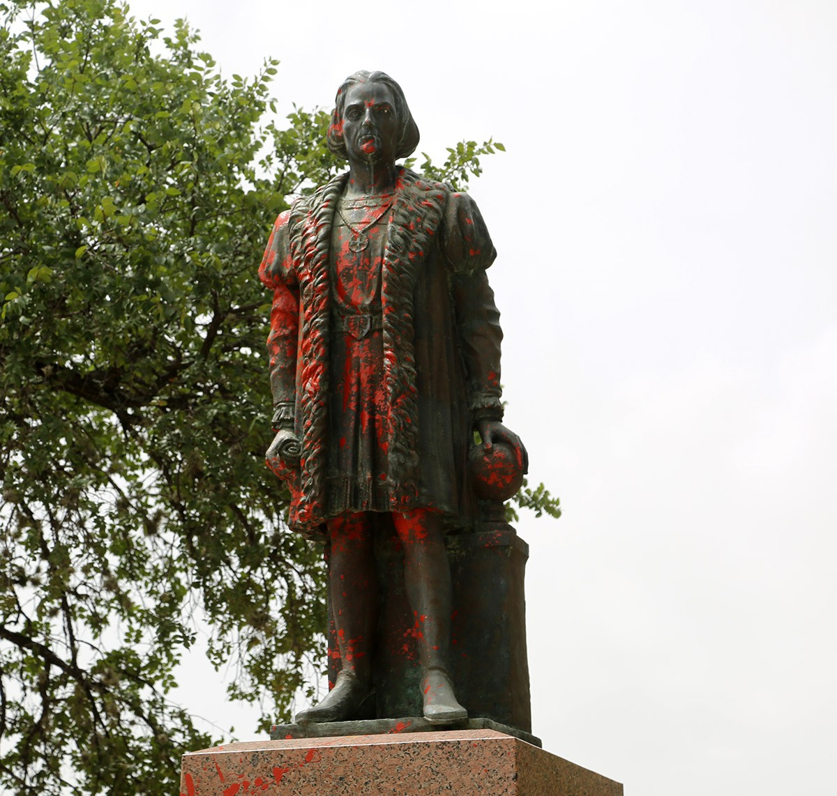 The Christopher Columbus statue is splattered in red paint Saturday, June 27, 2020, at Columbus Park, 200 Columbus St. Photo by Ben Olivo | Heron