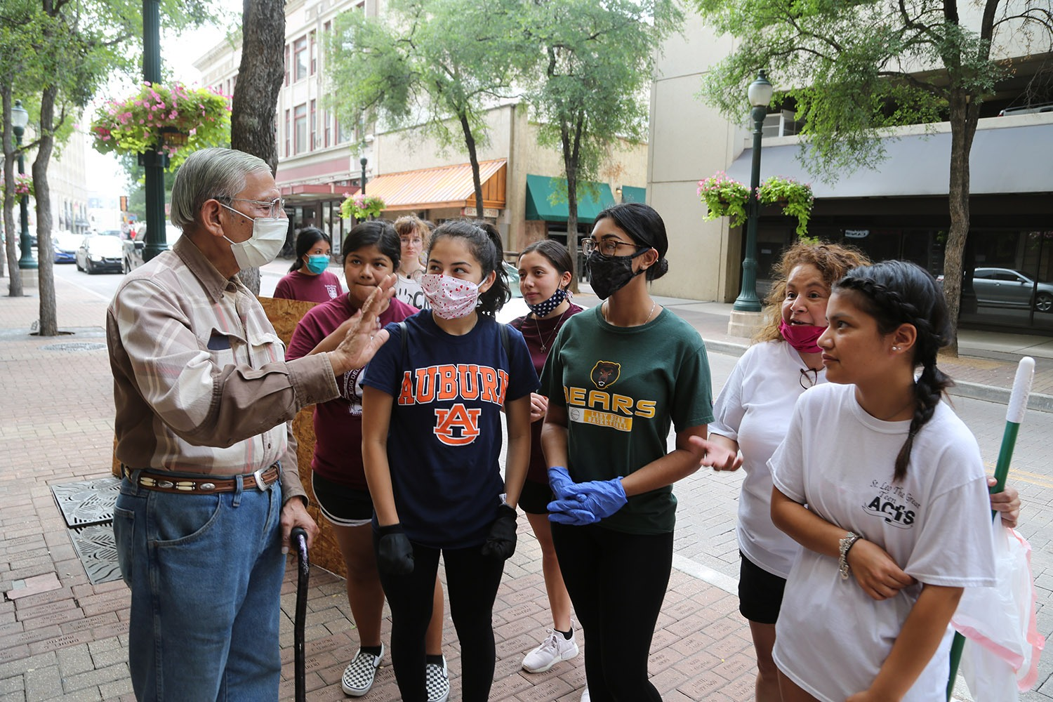 "Mike Ghori, owner of El Vaqueros, which sells ""custom-fitted boots, hats and orthotics,"" a victim of the looting the day before, imparts wisdom to some young volunteers, including Rylie Ruiz of Burbank on May 31, 2020. <b><em>Photo by Ben Olivo 