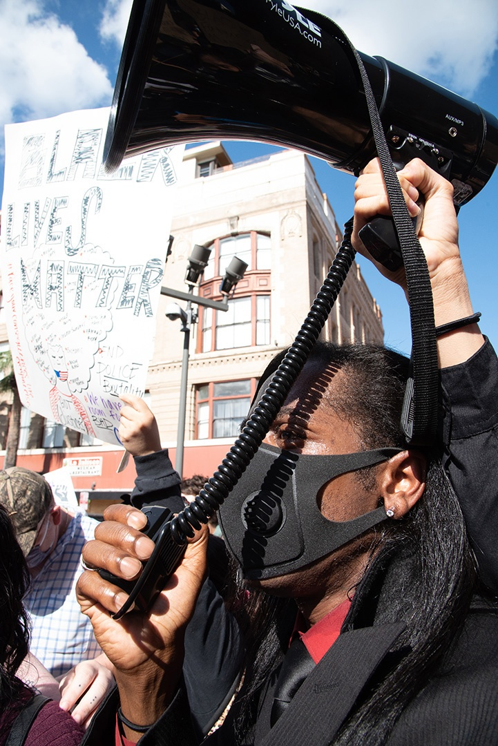 Pharaoh Clark, 32, speaks over a megaphone to Black Lives Matter protestors Thursday, June 4, 2020, in front of the Bexar County Courthouse. <b><em>Photo by V. Finster | Heron contributor</em></b>