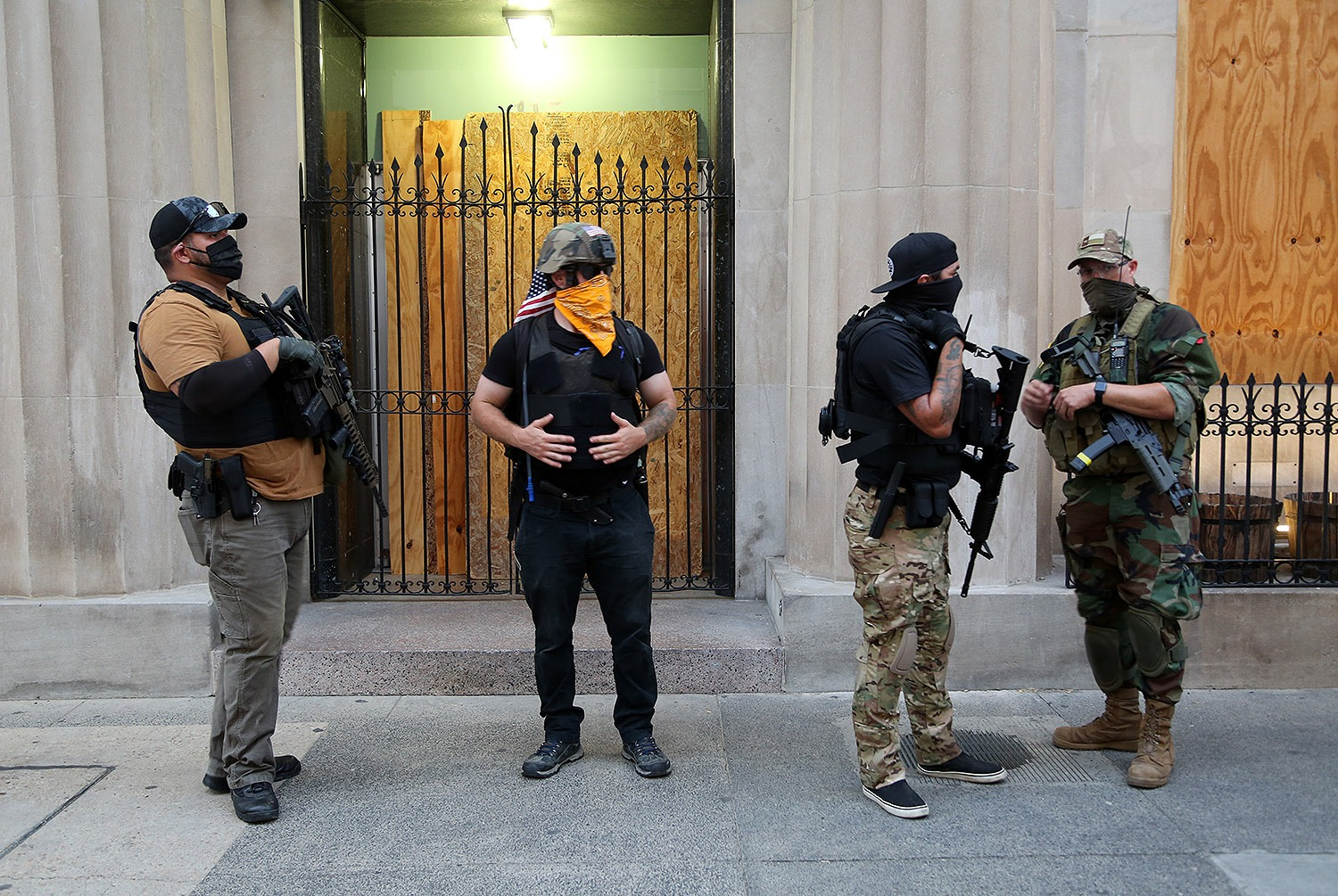 Armed men guard the 100 block of Broadway on Saturday, June 6, 2020, from what they describe as potential rioters. <b><em>Photo by Ben Olivo | Heron</em></b>
