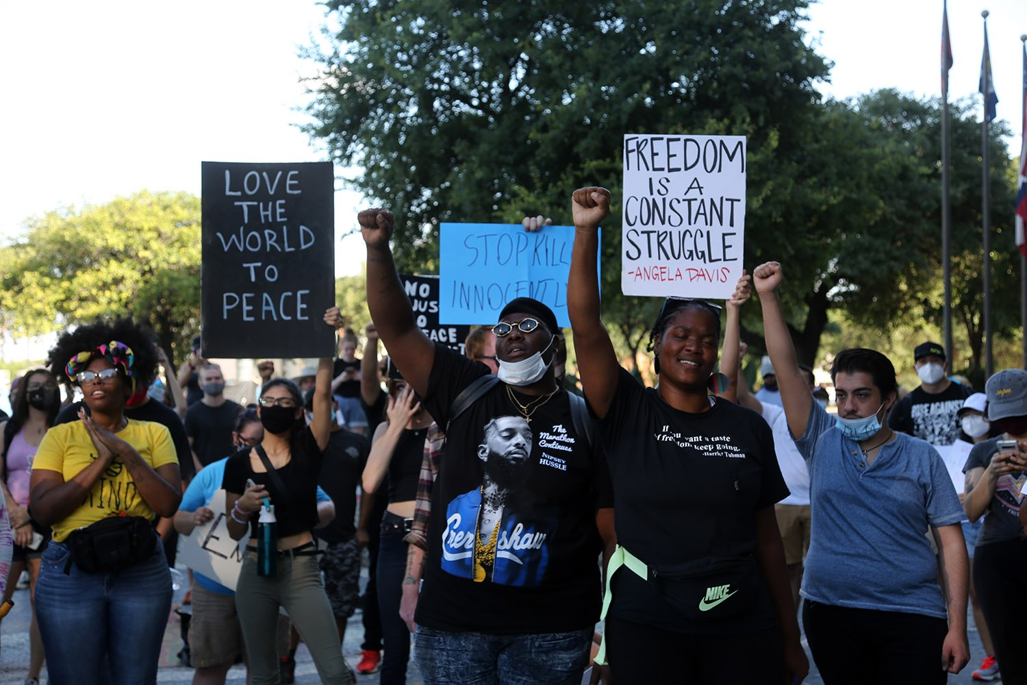 "Black Lives Matter protestors sing along to ""Glory"" by John Legend and Common during the Humans for Humanity rally against police brutality on June 6, 2020, at police headquarters on North San Rosa Avenue. <b><em>Photo by Ben Olivo 