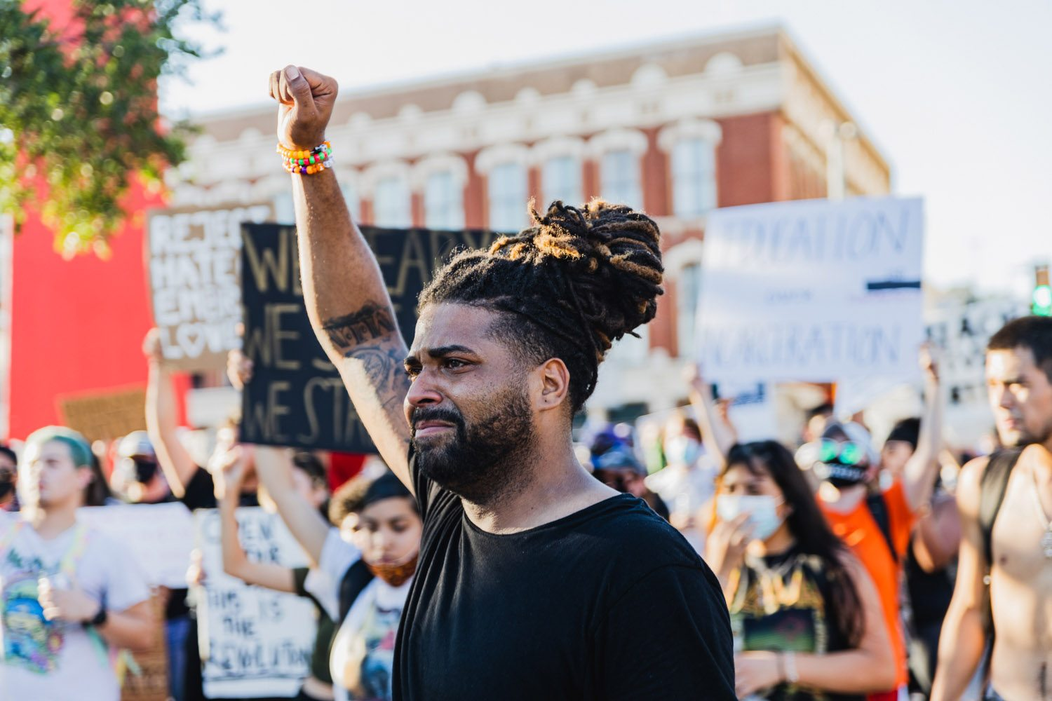 Organizer Antonio Lee gestures to the crowd during a Black Lives Matter protest at the Torch of Friendship on Monday, June 8, 2020. <b><em>Photo by Isaiah Alonzo | Heron contributor</em></b>