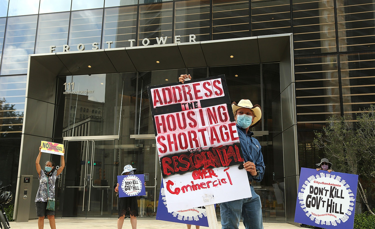 Caleb James, a resident of Government Hill since 2019, leads a protest in front of the Frost Tower on Saturday, July 18, 2020. At one time, a trust managed by Frost Bank and other entities were exploring converting residential homes in the neighborhood into a Starbucks. <b><em>Photo by Ben Olivo | Heron</em></b>