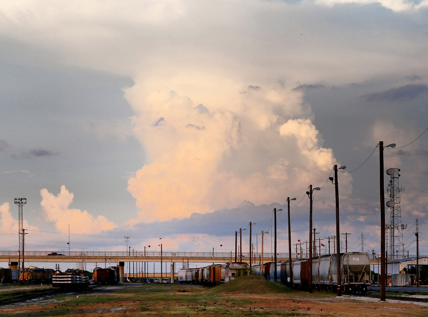 A large cloud hovers over the Union Pacific East Year as seen from North Pine Street. <b><em>Photo by Ben Olivo | Heron</em></b>