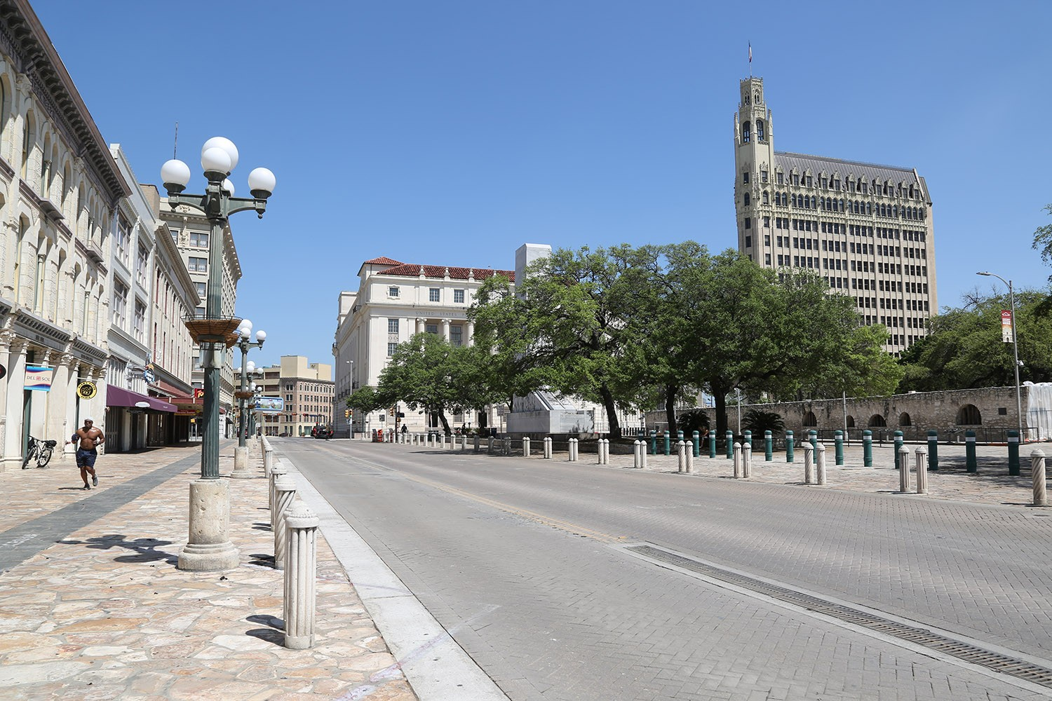 Alamo Plaza is nearly empty on Tuesday, March 24, 2020 amid coronavirus pandemic. <b><em>Photo by Ben Olivo | Heron</em></b>