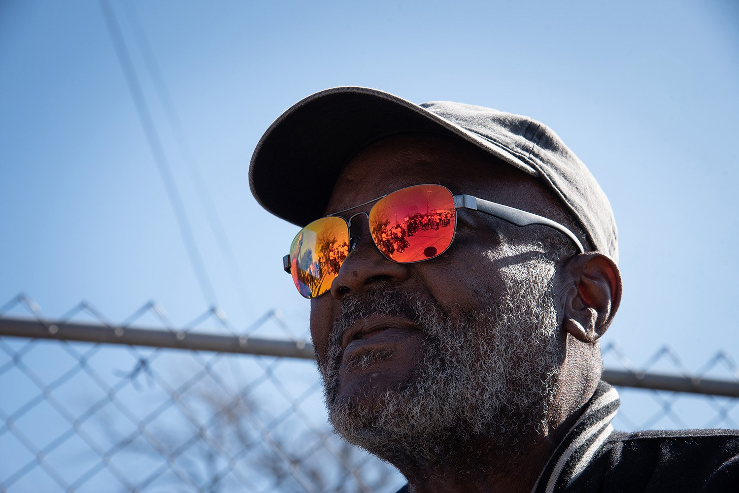 Charles Thorton, 66, watches the crowd walk by during the Martin Luther King, Jr. March on Jan. 20, 2020. <b><em>Photo by V. Finster | Heron contributor</em></b>