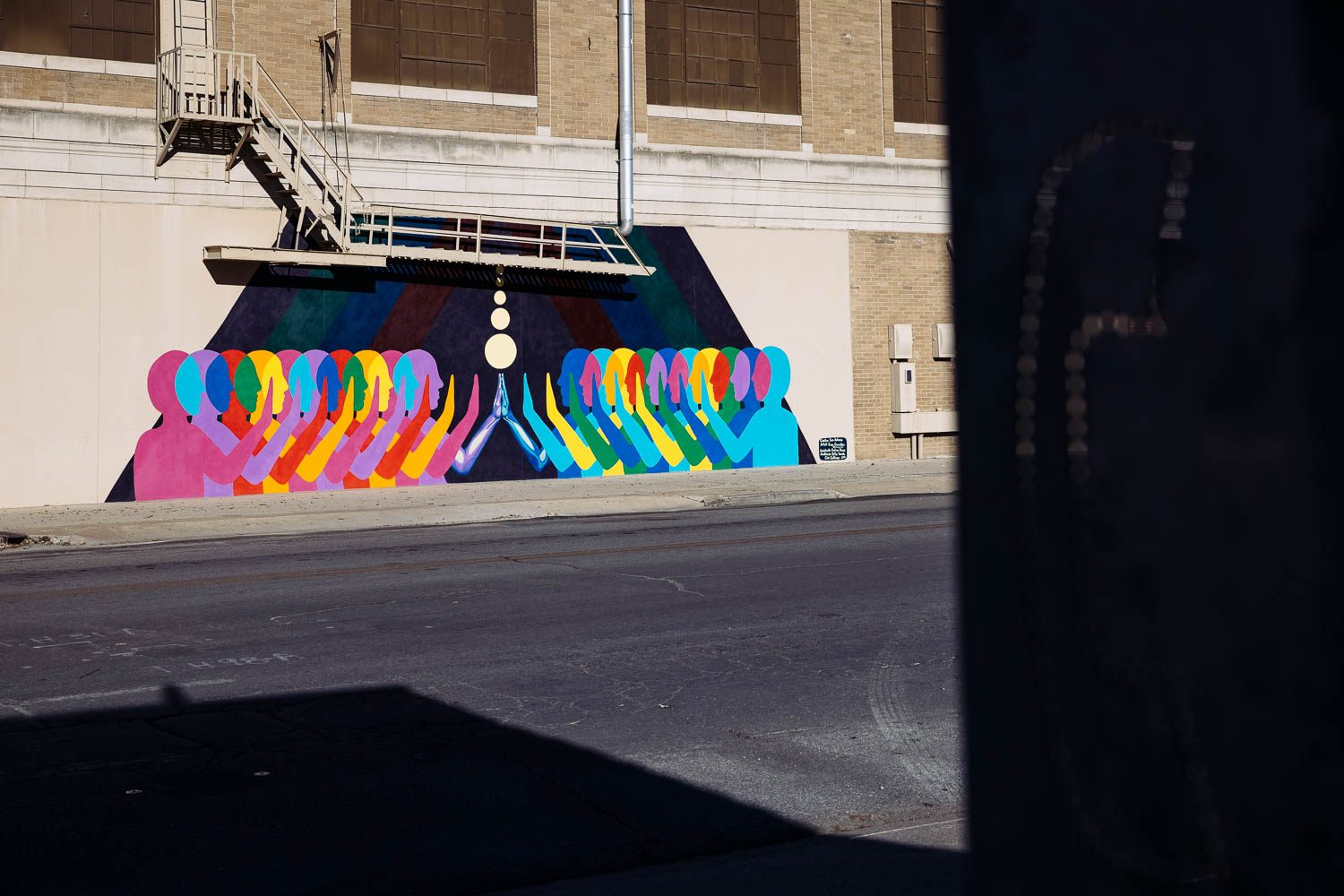 "New mural titled ""Touch"" by Suzy González adorns the wall outside Herweck's Art Supply on Broadway. <b><em>Photo by Chris Stokes 