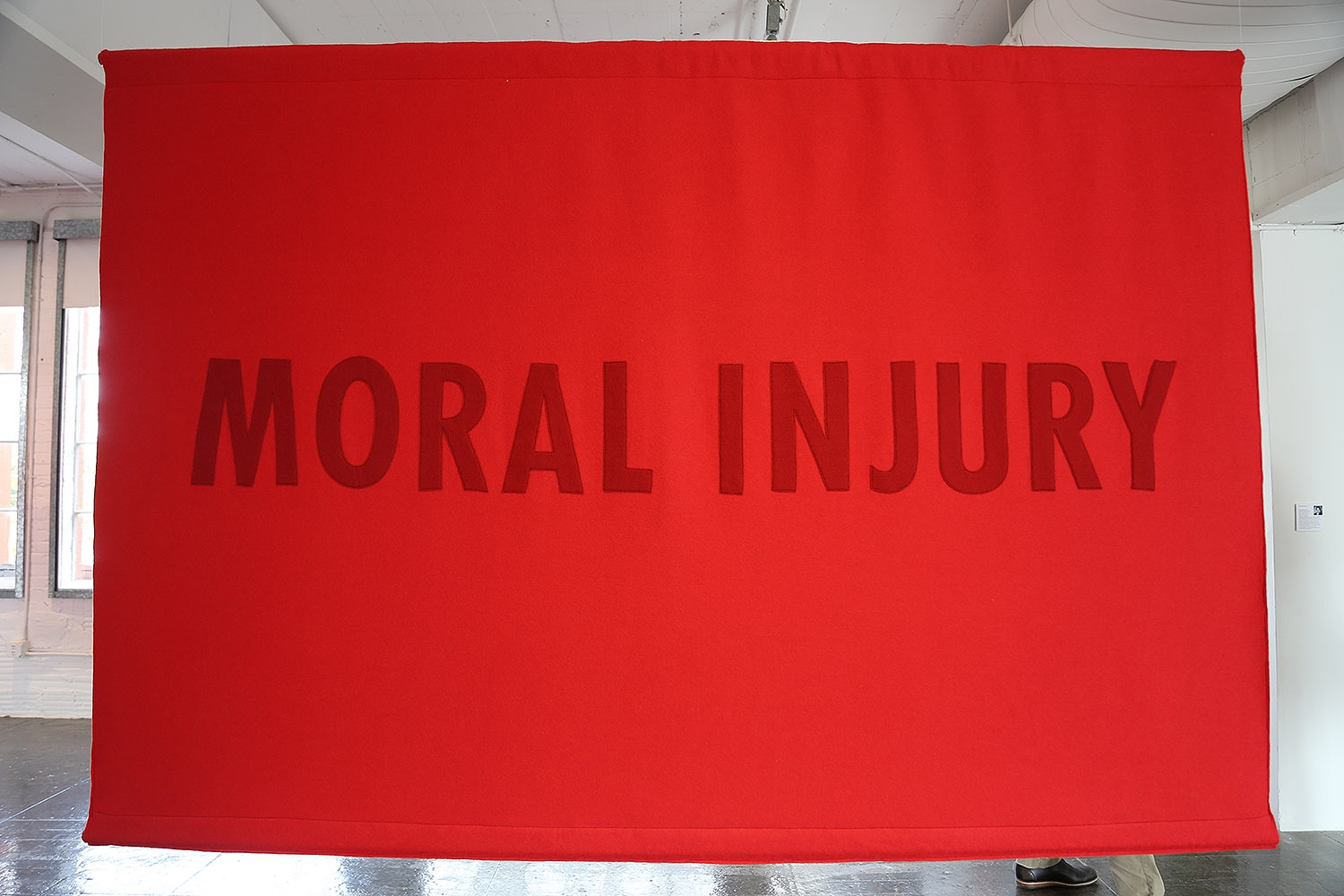 "A banner by Jenny Holzer on display in the ""Word on the Street"" exhibition at Artpace."