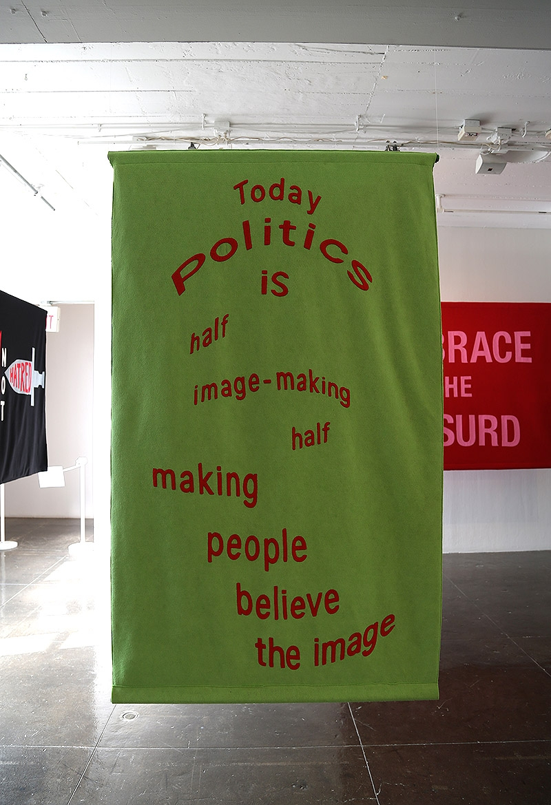 "A banner on display in the ""Word on the Street"" exhibition at Artpace."