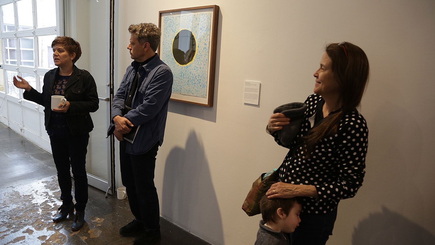 Jennifer Khoshbin (from left), Noah Khoshbin, Naomi Shihab Nye and her grandson Connor talk to the press at Artpace on Wednesday.