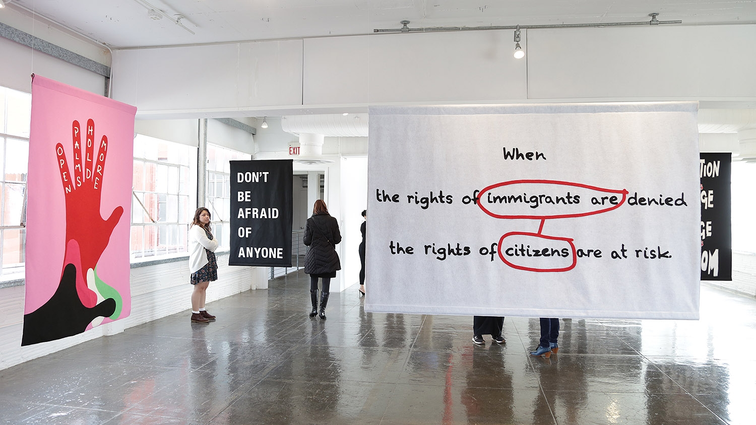 """Word on the Street"" exhibition of political and poetic street banners is currently on display at Artpace."