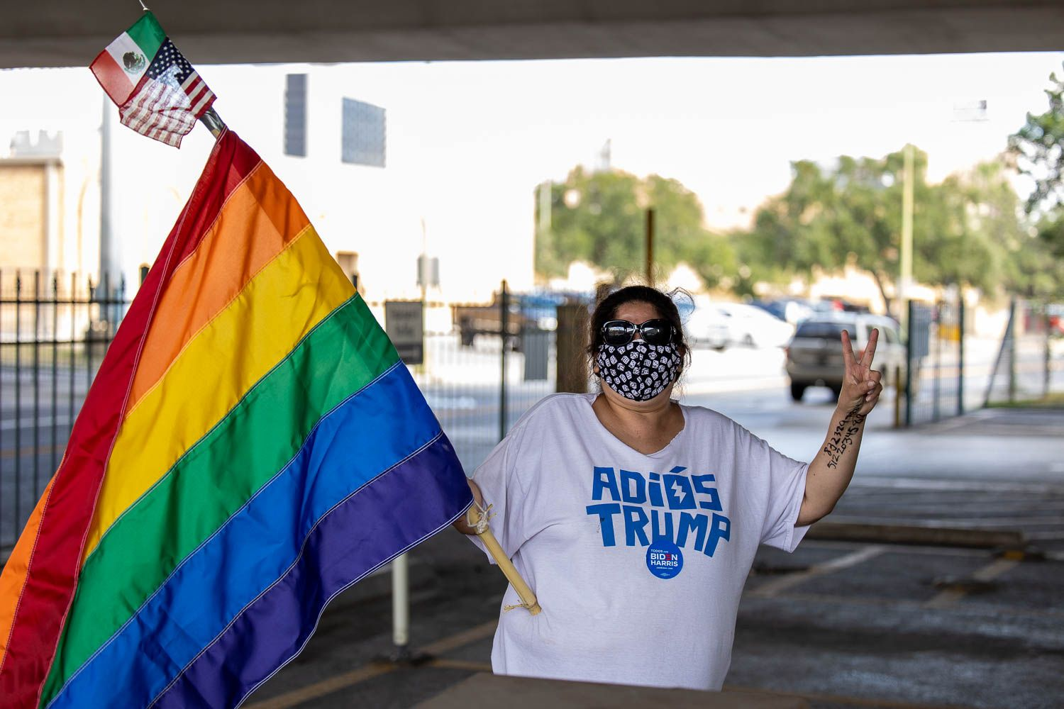 "Molly Wright of San Antonio wears a shirt that says ""Adios Trump"" (good-bye Trump) as San Antonians caravaned through downtown to celebrate the President-elect Joe Biden and Kamala Harris's win on November 7, 2020. Photo by Stephanie Marquez 