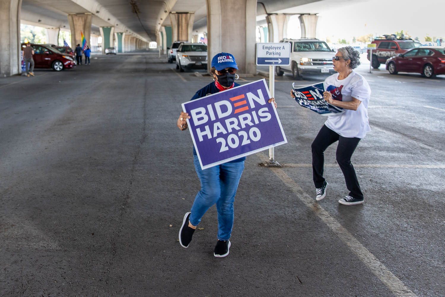 Carla Salinas and Justa Garcia-Higby of San Antonio dance under the highway 35 as caravan returned back from  a downtown drive to celebrate the President-elect Joe Biden and Kamala Harris's win on November 7, 2020. Photo by Stephanie Marquez | Heron contributor