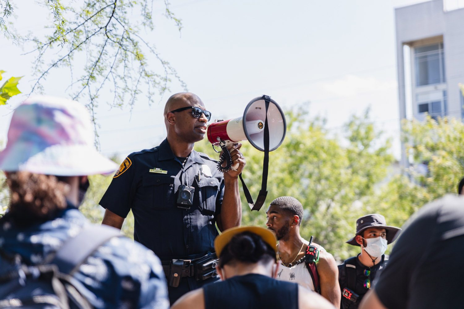 Officer Douglas Greene speaks at a Black Lives Matter protest and rally on Monday, June 8, 2020, at Blue Star Arts Complex. <b>Photo by Isaiah Alonzo | Heron contributor</b>