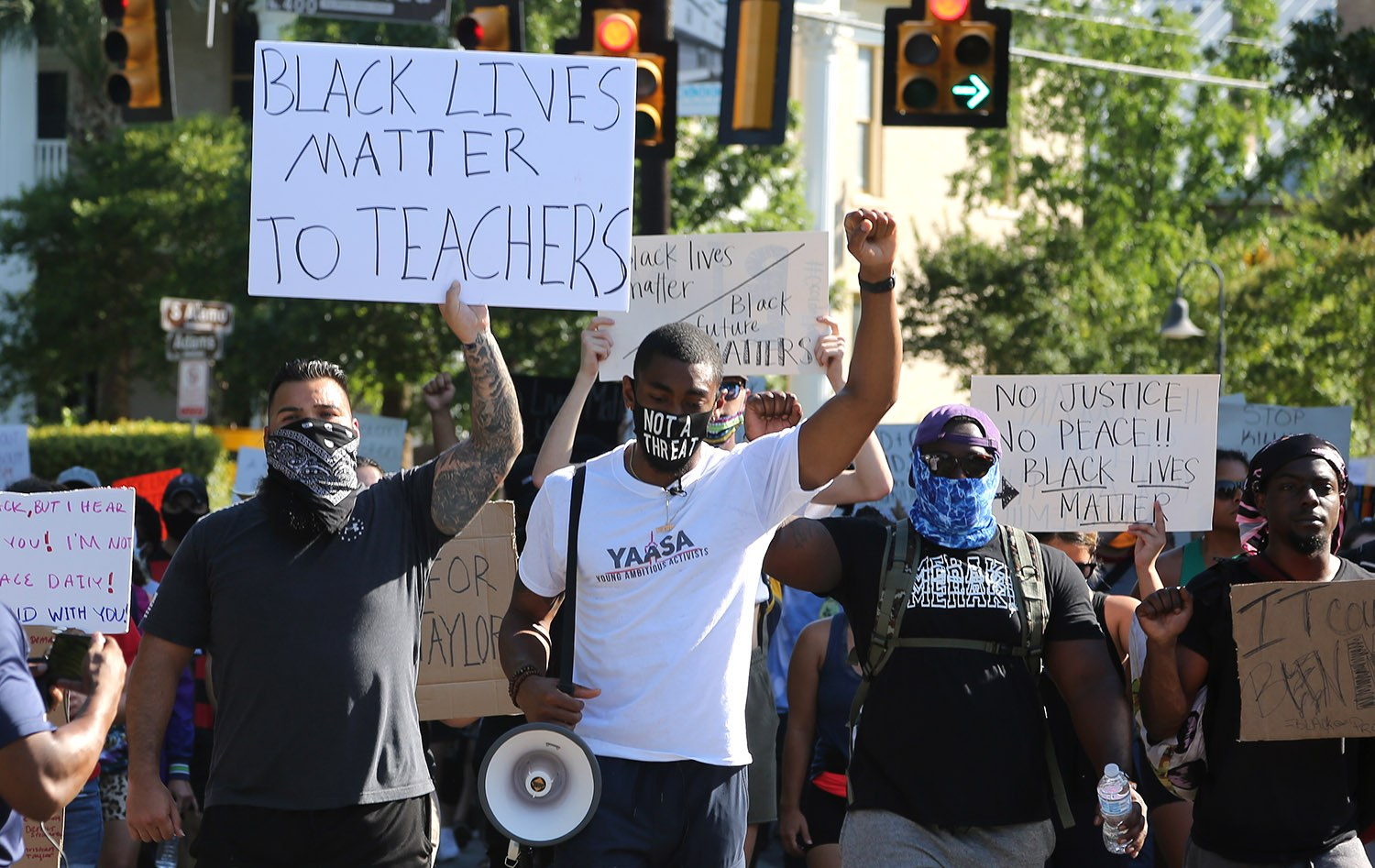 The Black Lives Matter protest and march organized by the Ambitious Young Activists makes its way through King William on the way to La Villita this afternoon. <b>Photo by Ben Olivo | Heron</b>