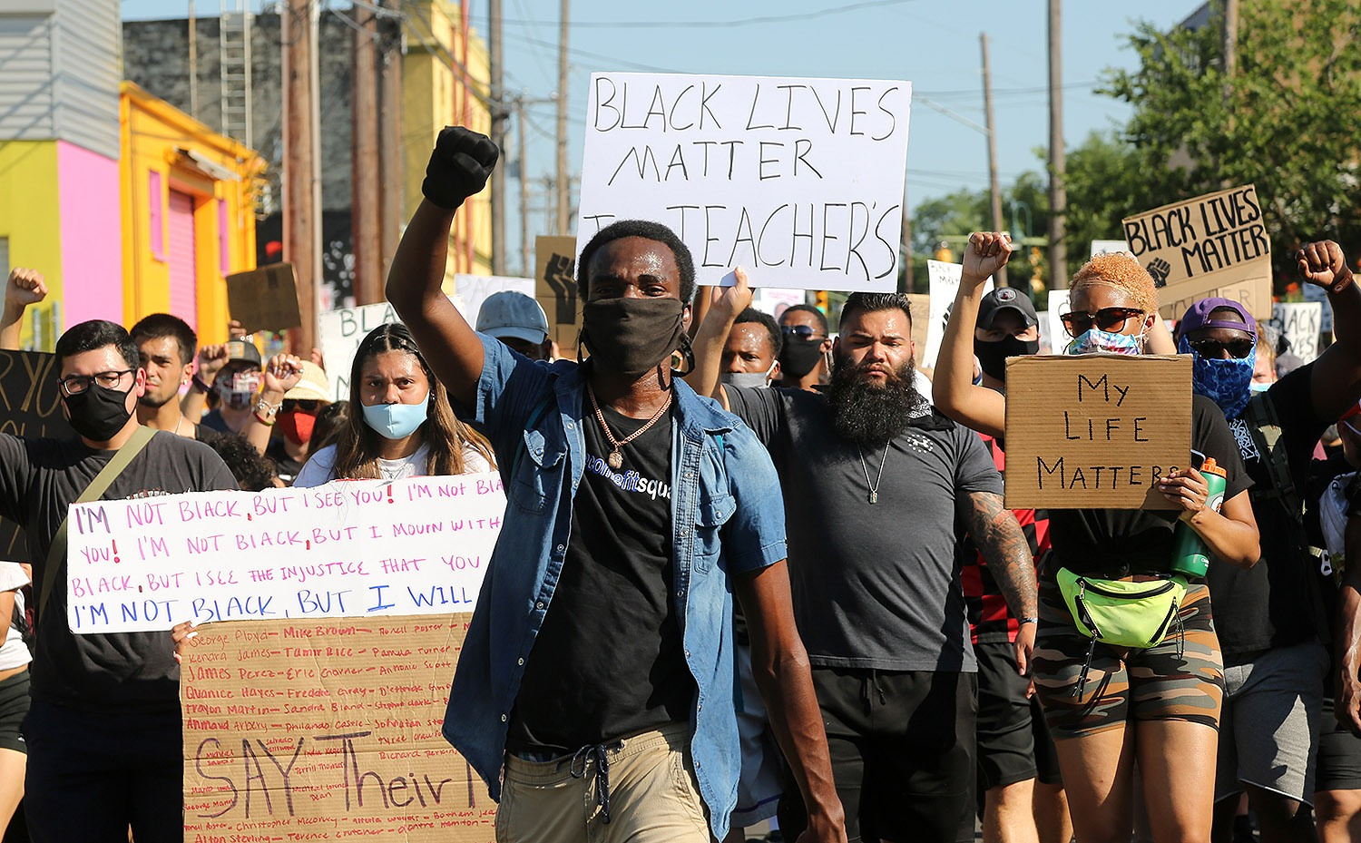 Isaiah Adams marches with roughly 2,000 other Black Lives Matter protestors through Southtown on Monday, June 8, 2020.  <b>Photo by Ben Olivo | Heron</b>