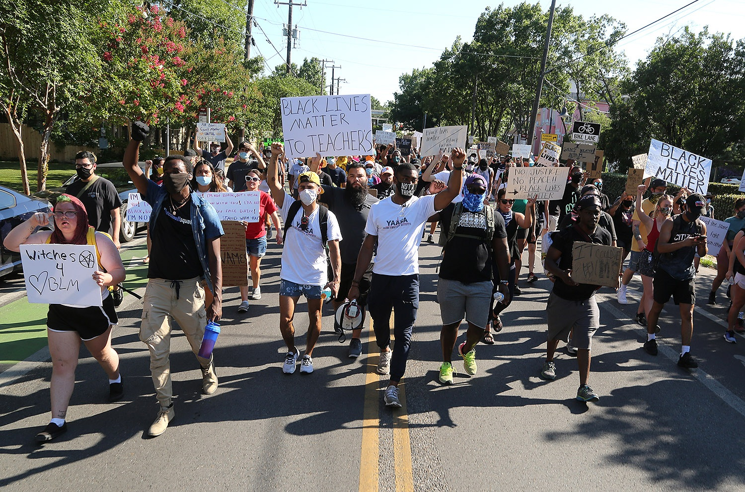 The Black Lives Matter protest and march organized by the Ambitious Young Activists makes its way through King William on the way to La Villita Monday afternoon, June 8, 2020.  <b>Photo by Ben Olivo | Heron</b>