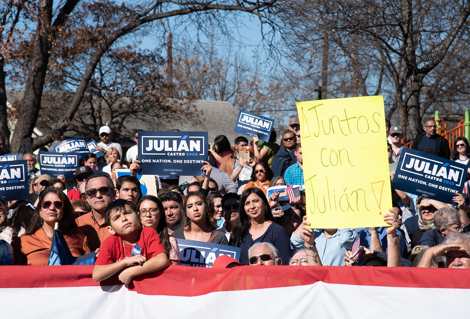 Attendees hold signs during Julián Castro's announcement to run in the 2020 presidential election Jan. 12 at Plaza Guadalupe. Photo: V. Finster | Heron contributor