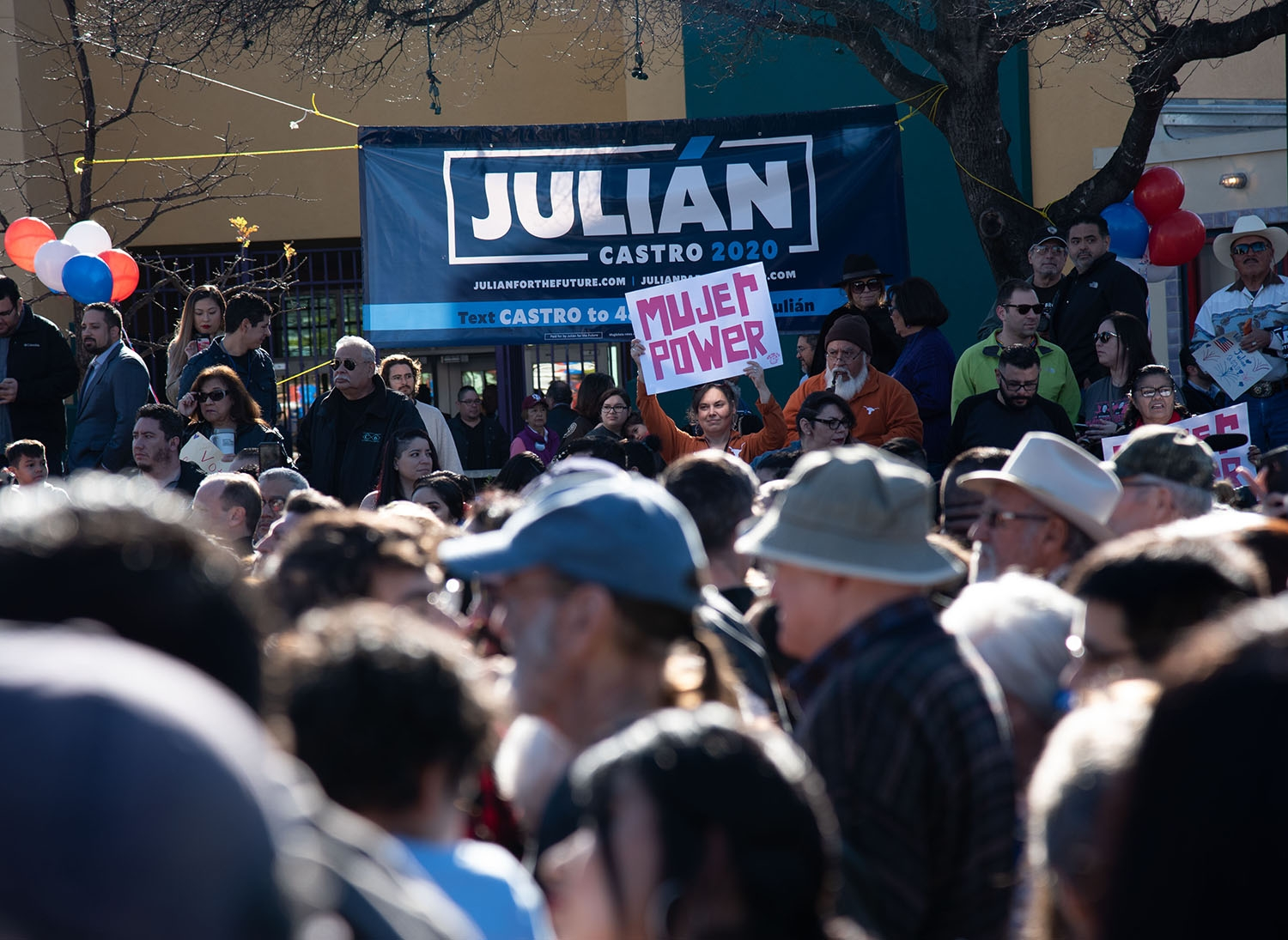 Attendees wait for a special announcement from Julián Castro to begin Jan. 12 at Plaza Guadalupe. Photo: V. Finster | Heron contributor