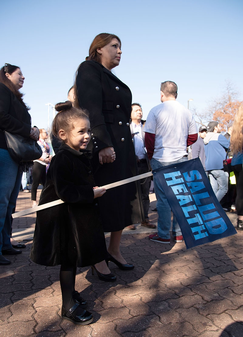 Lizzett Cima holds Hailey Cima, 2, by the hand before Julián Castro makes his special announcement Jan. 12 at Plaza Guadalupe. Photo: V. Finster | Heron contributor