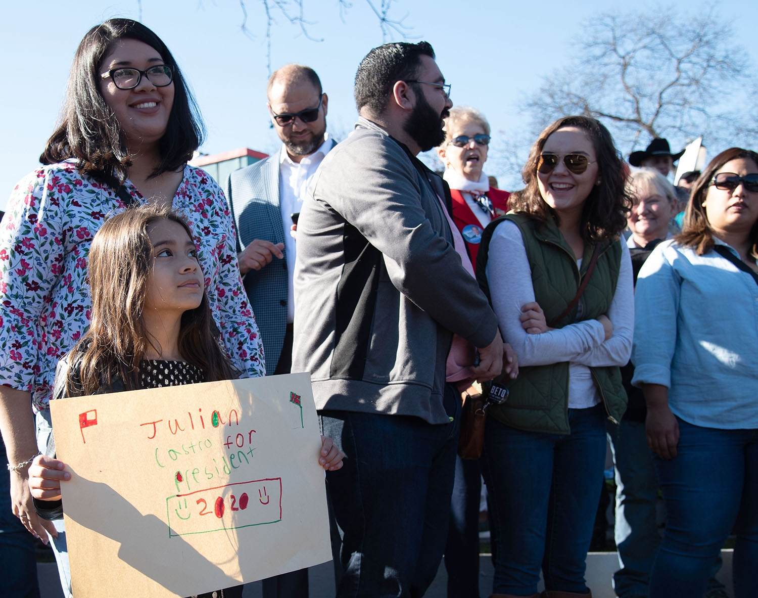 San Antonio residents Daritza Coronel and Michelle Castillo, 8, wait for the special announcement from Julián Castro to begin Jan. 12 at Plaza Guadalupe. Photo: V. Finster | Heron contributor