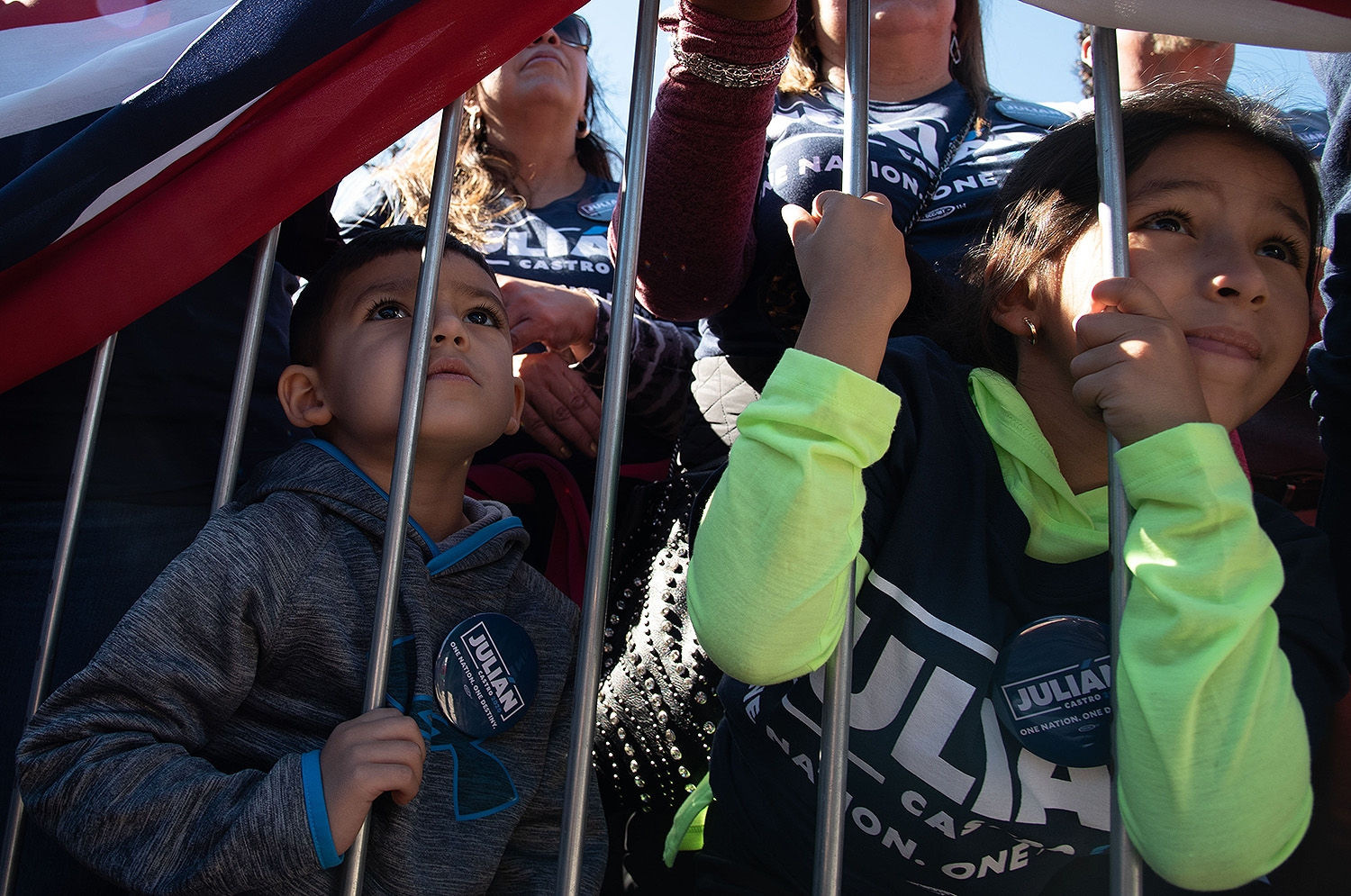 Nathan Guerrero, 3, and Sophia Guerrero, 6, listen to former San Antonio Mayor Julián Castro as he announces his run for president in the 2020 election Saturday morning at Plaza Guadalupe. Photo: V. Finster | Heron contributor