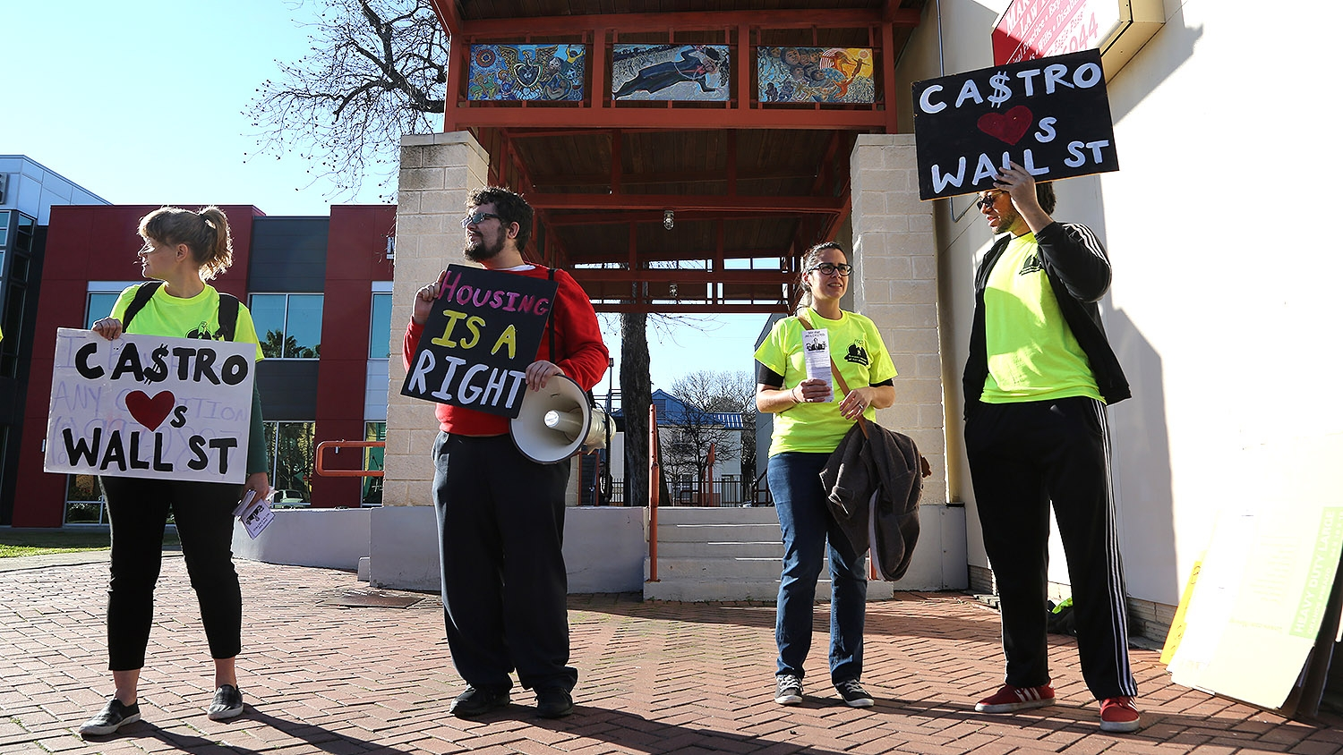 Jacinta Mack (from left), Todd Heeg, Rachell Tucker and Marlon Davis protest former HUD Secretary and Mayor Julián Castro's housing policies they say spurred gentrification in San Antonio and throughout the U.S. Photo: Ben Olivo | Heron