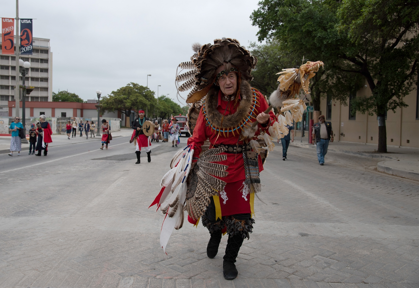 Milo Colton, a professor of criminal justice at St. Mary's University, dances down Dolorosa Street during San Antonio's 23rd annual César E. Chávez March for Justice on March 30. Photo by V. Finster | Heron