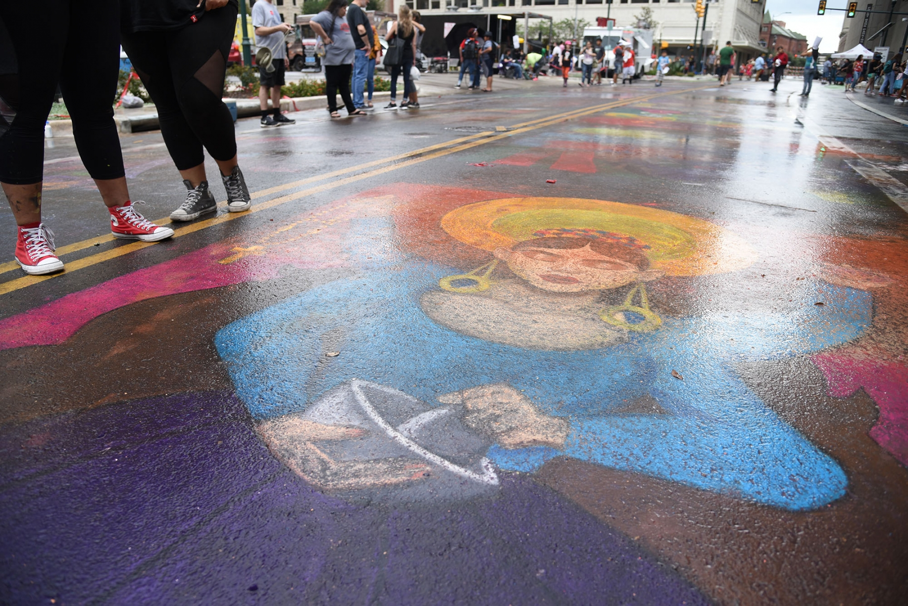 Chalk drawings fade after a brief rain during the 15th  annual Chalk It Up Oct. 13 in downtown San Antonio. <em><b>Photo by V. Finster | Heron</b></em>