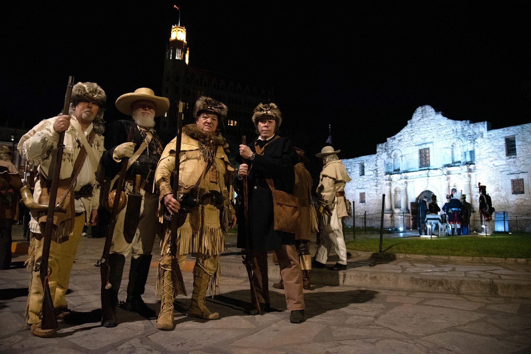 Ron Moulton (from left), Raleigh Conklin, David P. Crockett and Allen Dillon portray Alamo defenders during the Dawn at the Alamo ceremony March 6, 2019, at Alamo Plaza.