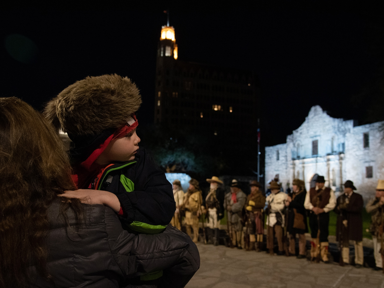 Archie Russell, 5, from Johnson City Tenn., watches the Dawn at the Alamo ceremony March 6, 2019, at Alamo Plaza.
