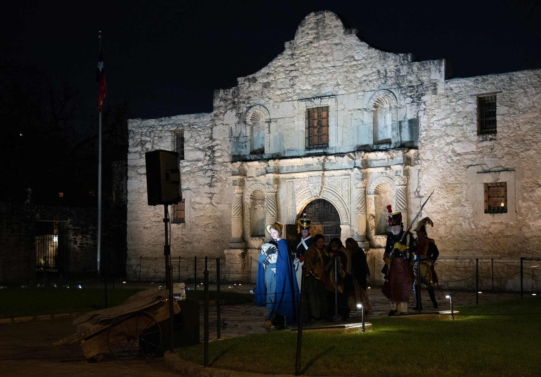 Katie Dillard, portraying Susanna Dickinson, is escorted out of the Alamo by Gen. Santa Anna's men during the Dawn at the Alamo ceremony March 26, 2019, at Alamo Plaza.