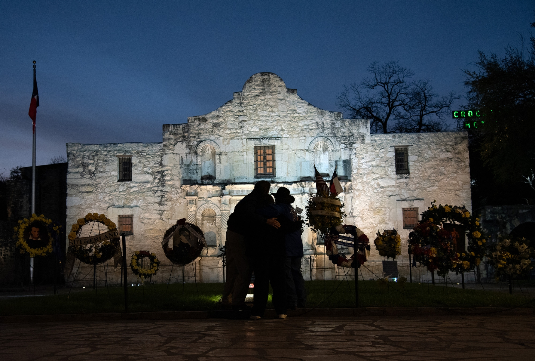 Descendants of Alamo defenders lay flower wreaths in front of the Alamo after the Dawn at the Alamo ceremony March 6, 2019.