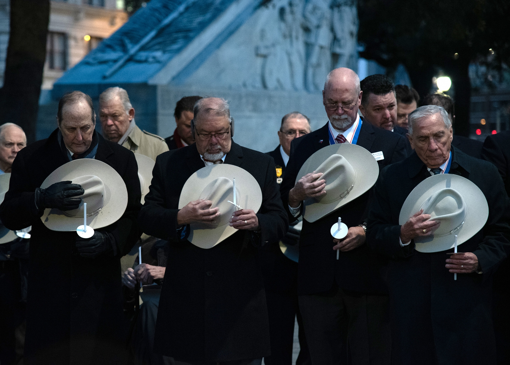 Attendees observe a moment of silence during Dawn at the Alamo ceremony March 6, 2019, at Alamo Plaza.